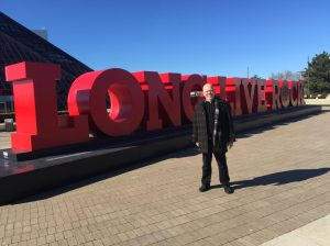 Steve standing in front of Long Live Rock sign