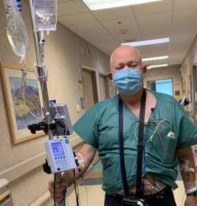 Steve, holding his IV cart, wearing his monitoring gear