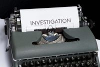 paper in typewriter says Investigation